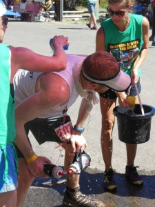 Like most runners, Brian Miller gets sponged down at Michigan Bluff (SRN Photo)