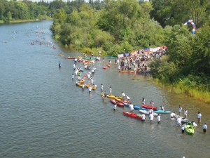 Racers stream into the finish and an army of volunteers pass the boats on up to the shore. (SRN photo)