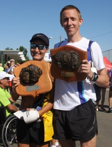 Winners Midori Sperandeo and Brad Poore proudly display their buffalo chip plaques. (Photo and awards by Abe Underwood)