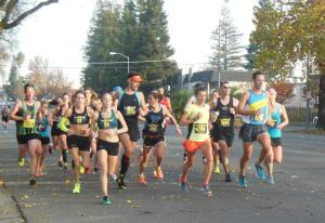 The 2:42 pace group at mile 14 of the 2014 CIM. (SRN photo)