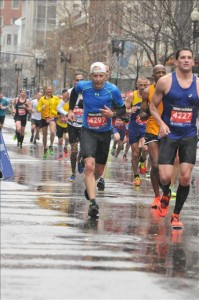 The author running at wet Boston Marathon (Photo courtesy of Dan Weintraub)